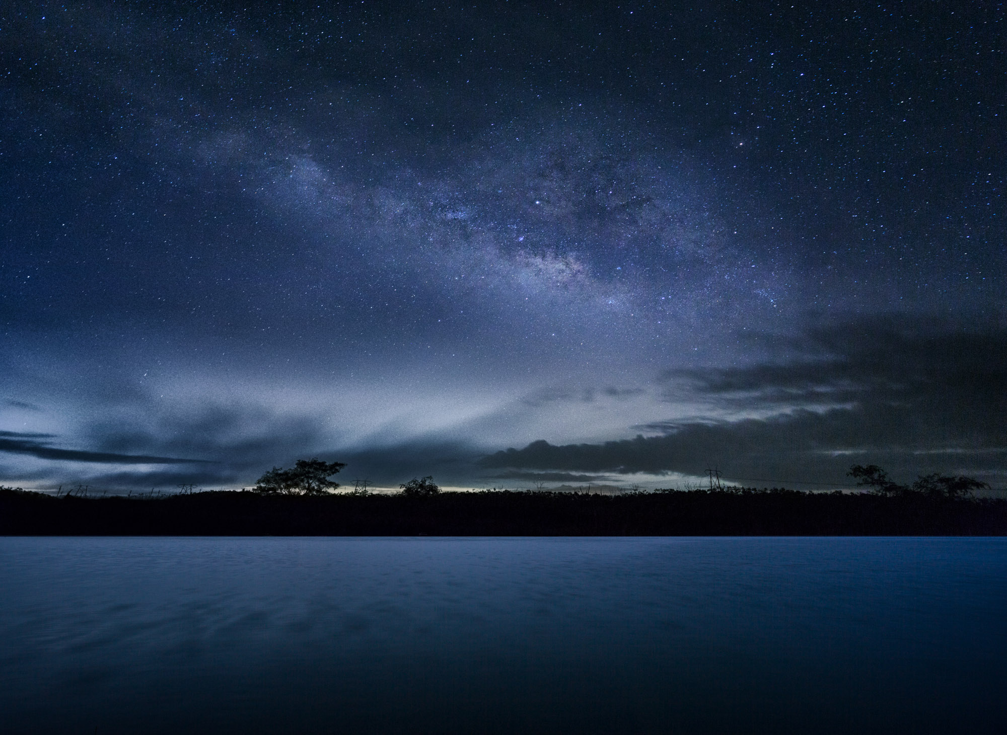 long exposure astrophotography of the milky way in the USA beside a lake in Florida USA