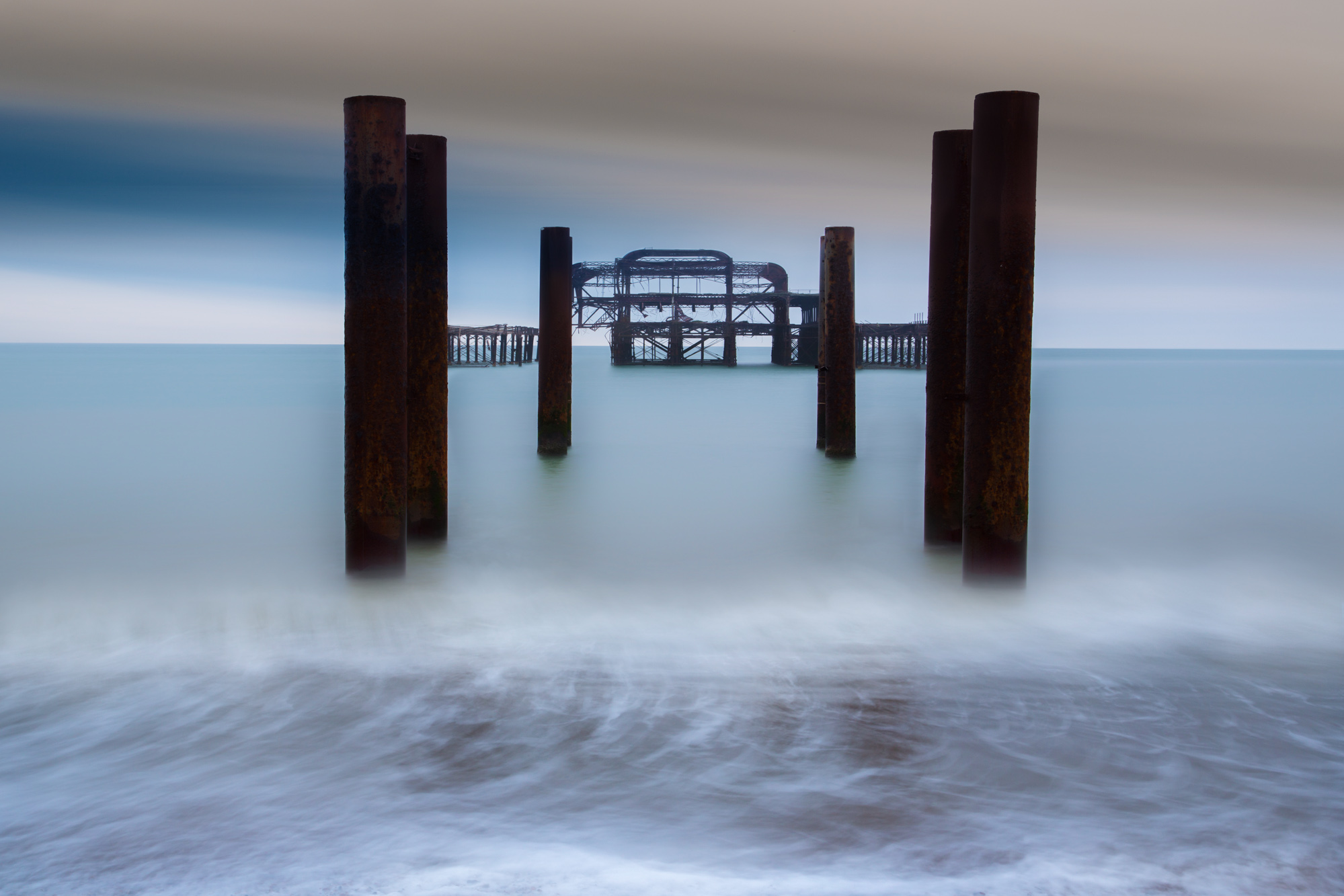 minimal long exposure photograph of the remains of the derelict West Pier in Brighton in the UK