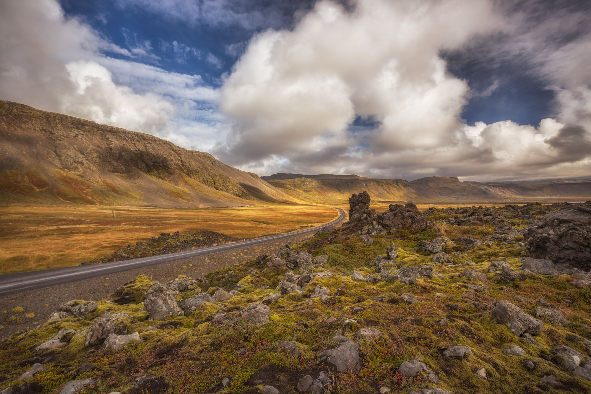 antonyz long exposure landscape photograph of a roadway cutting through the wild countryside in Iceland