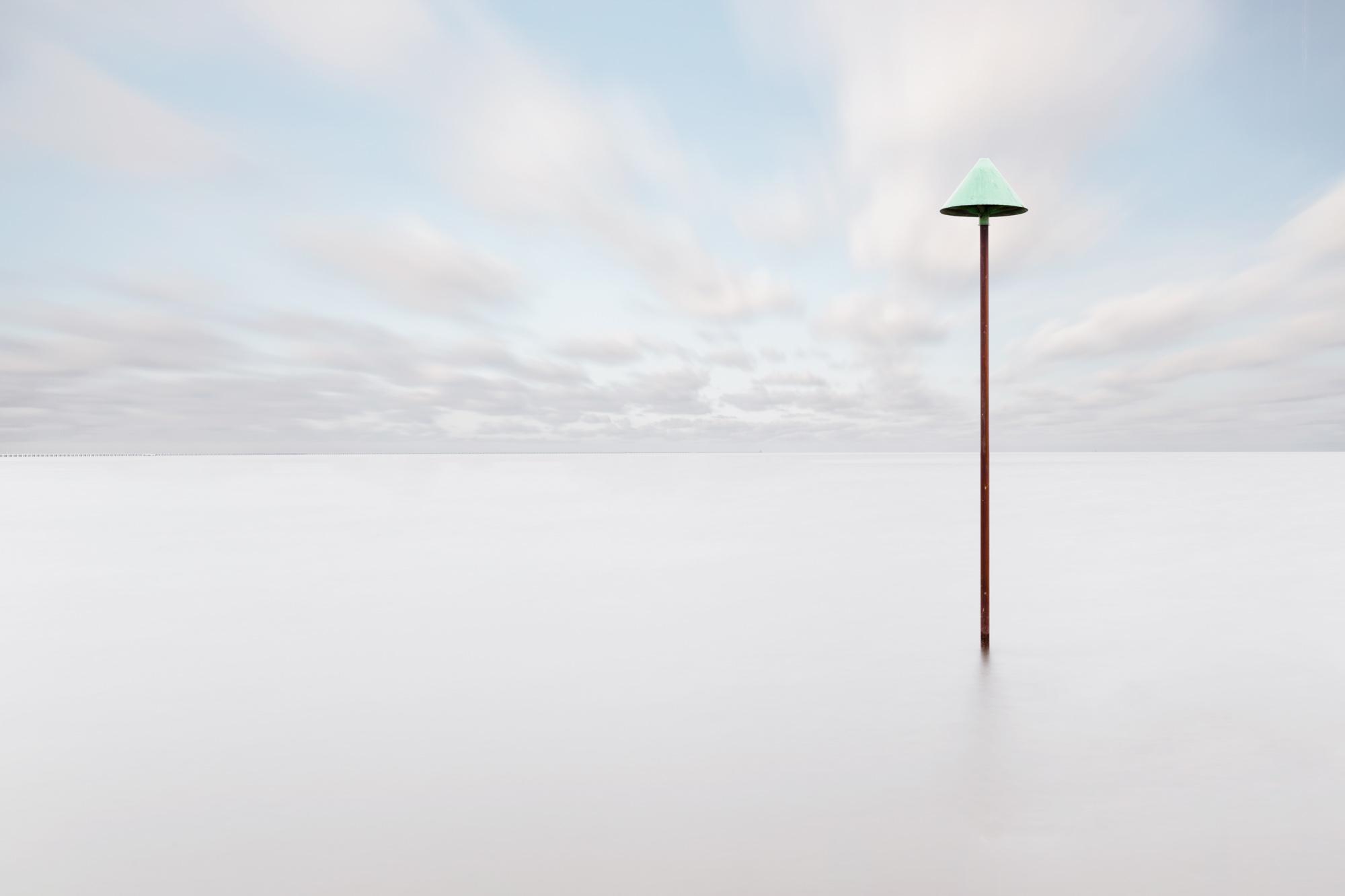 antonyz long exposure landscape minimal photograph of post in the sea