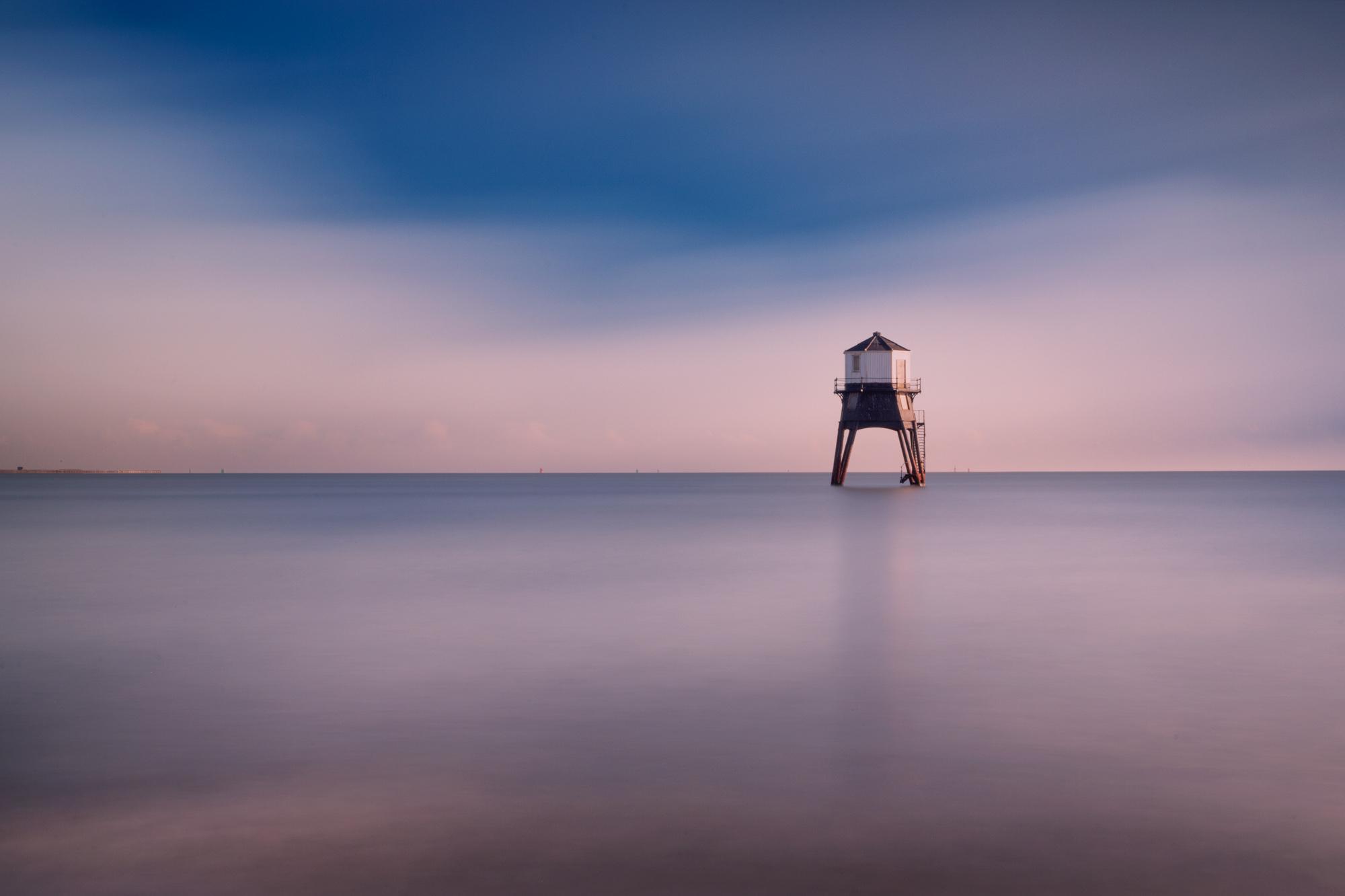 antonyz long exposure landscape photograph of Dovercourt lighthouse at sunrise in essex uk