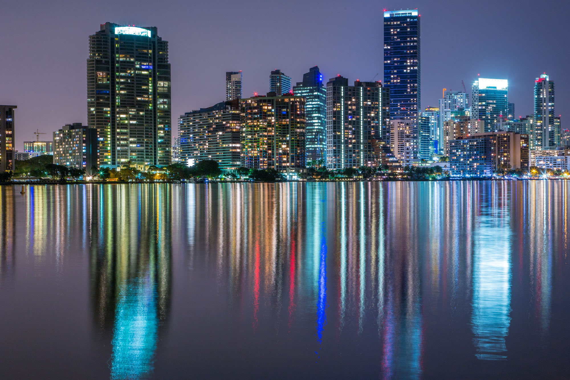 long exposure night photography of downtown Miami skyline reflected at night illuminated by Biscayne Bay in Florida USA