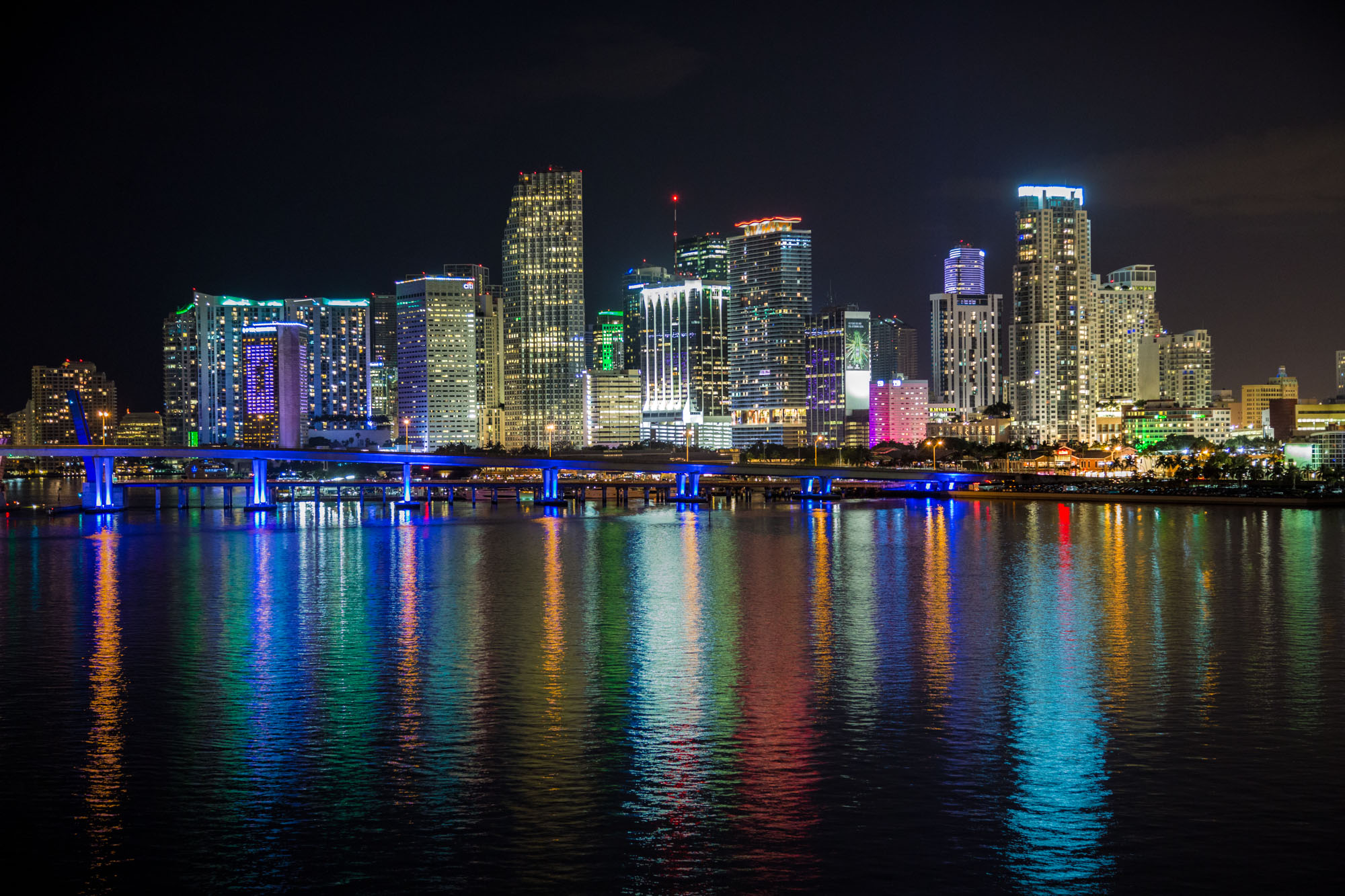 long exposure night photography of downtown Miami skyline at night illuminated by Biscayne Bay in Florida USA