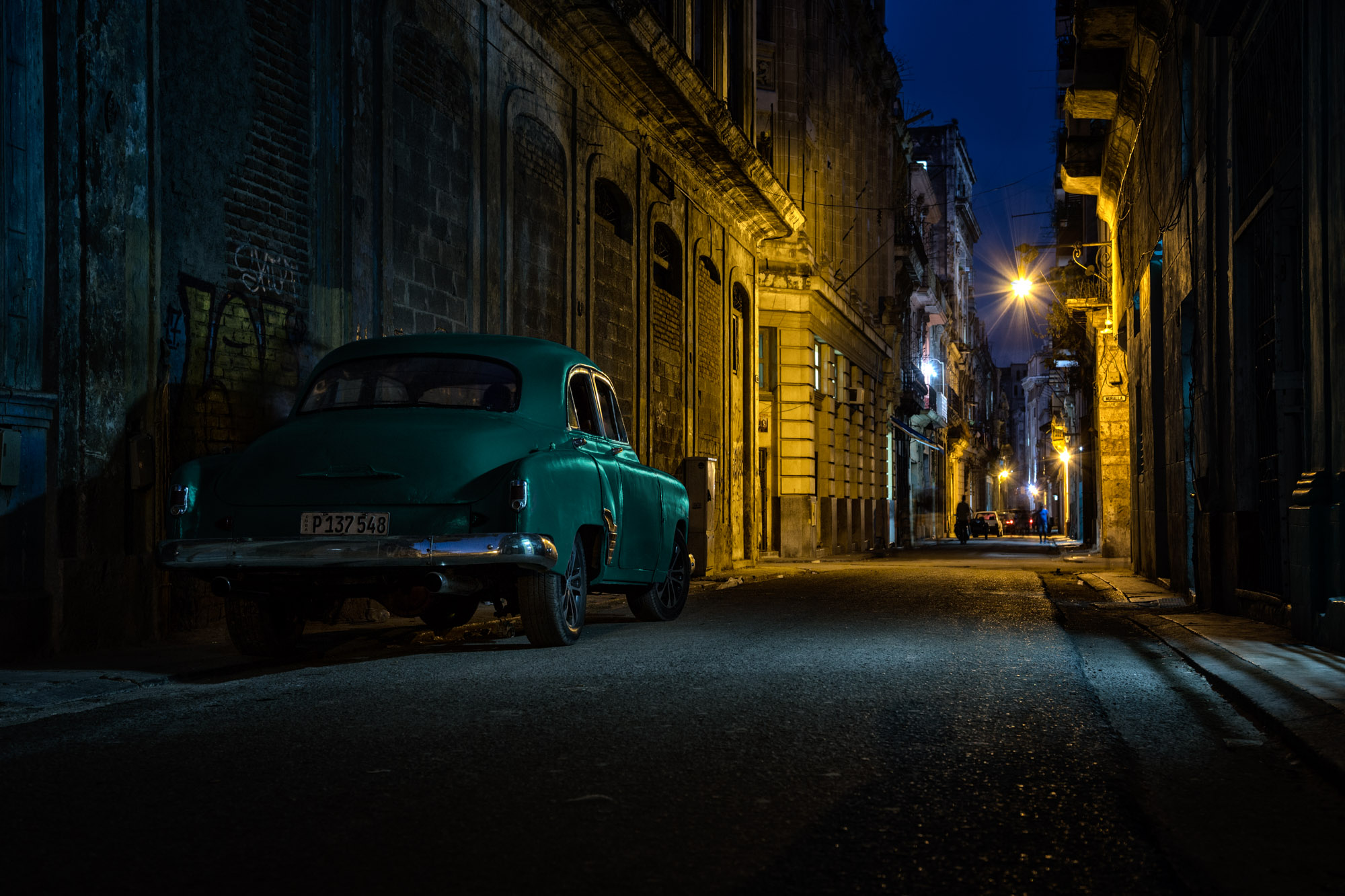 long exposure night photography of old Havana with a parked classic vintage America car in Cuba
