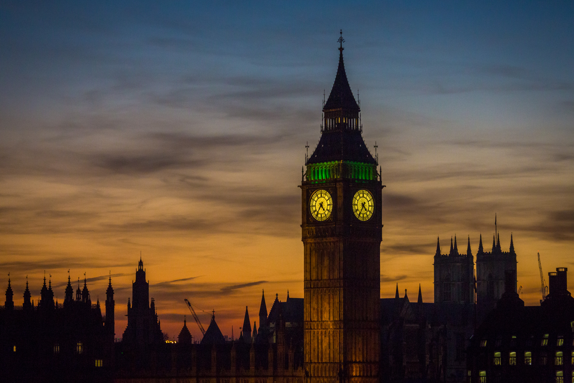 long exposure night photography of the Elizabeth Clock Tower known as Big Ben in London at sunset with silhouetted architecture