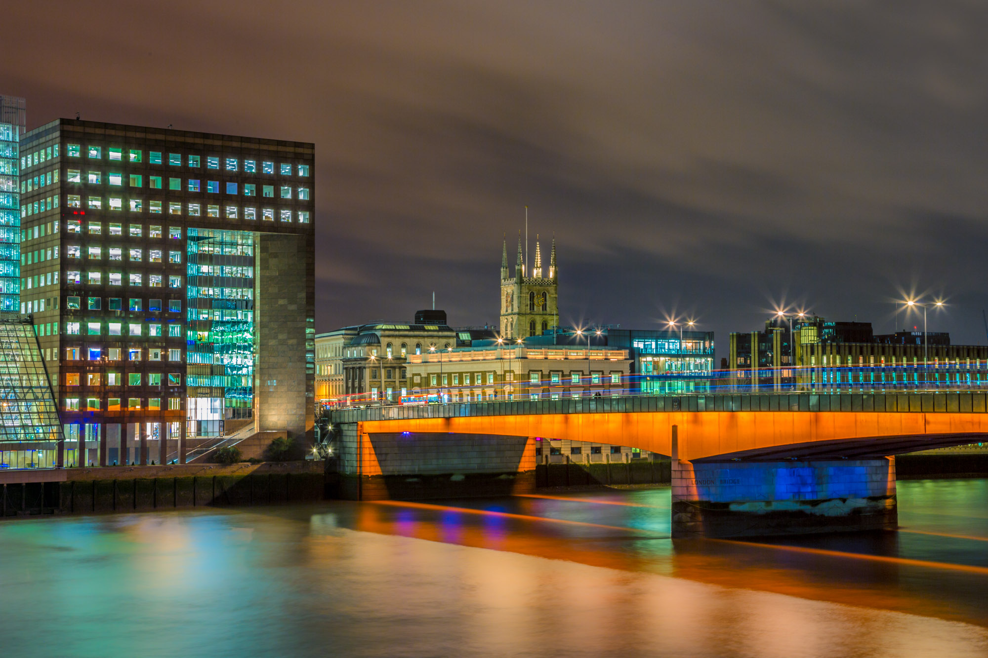 long exposure night photography of London Bridge and Southwark Cathedral viewed from above in lights
