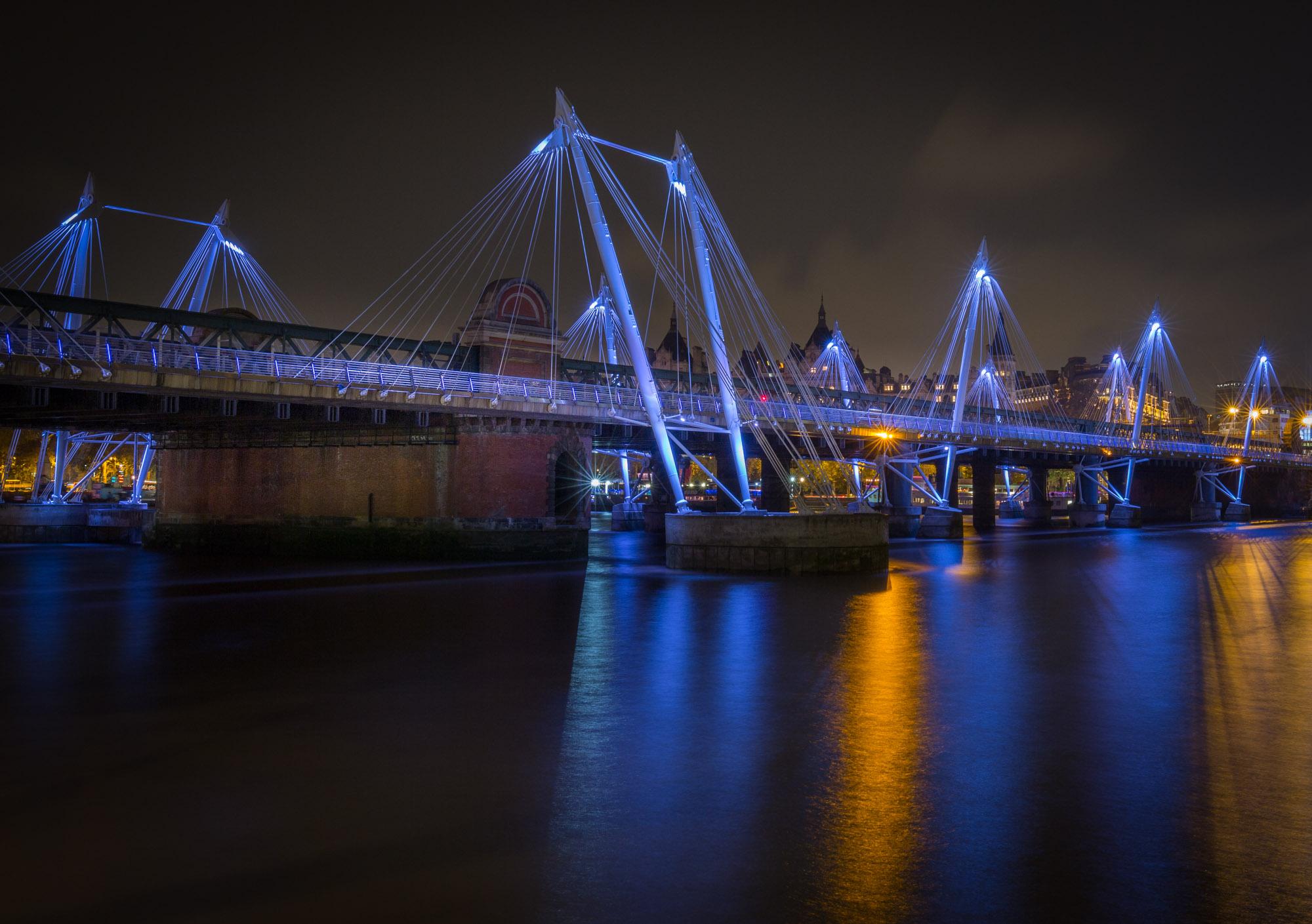long exposure night photography of Hungerford Bridge in London UK