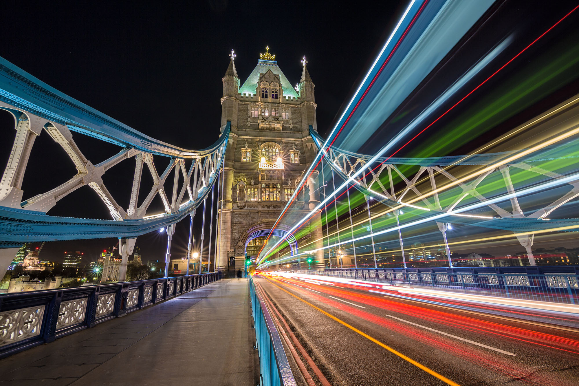 long exposure night photography of Tower Bridge in London with passing traffic captured as light trails