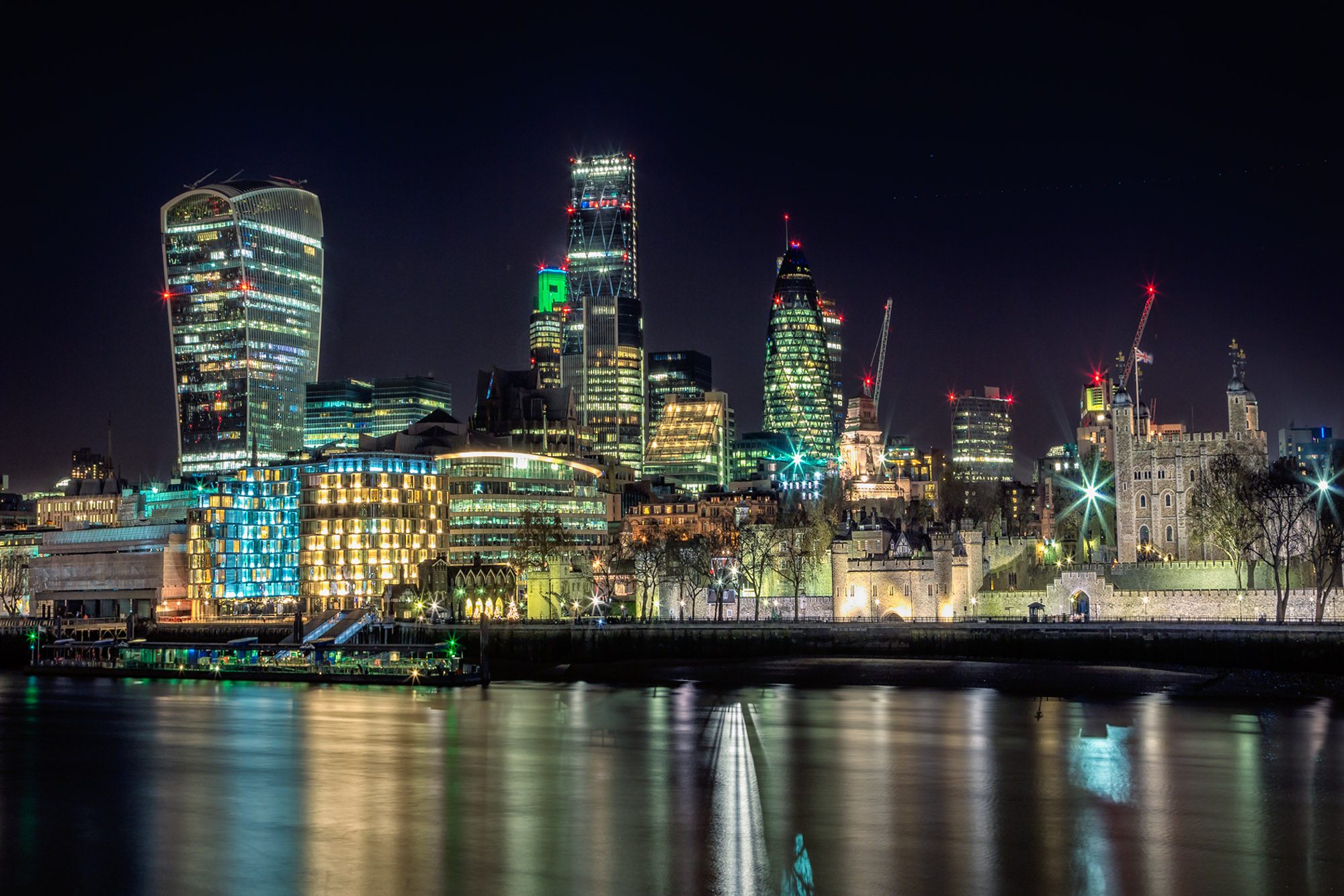 long exposure night photography of the London skyline beside the River Thames