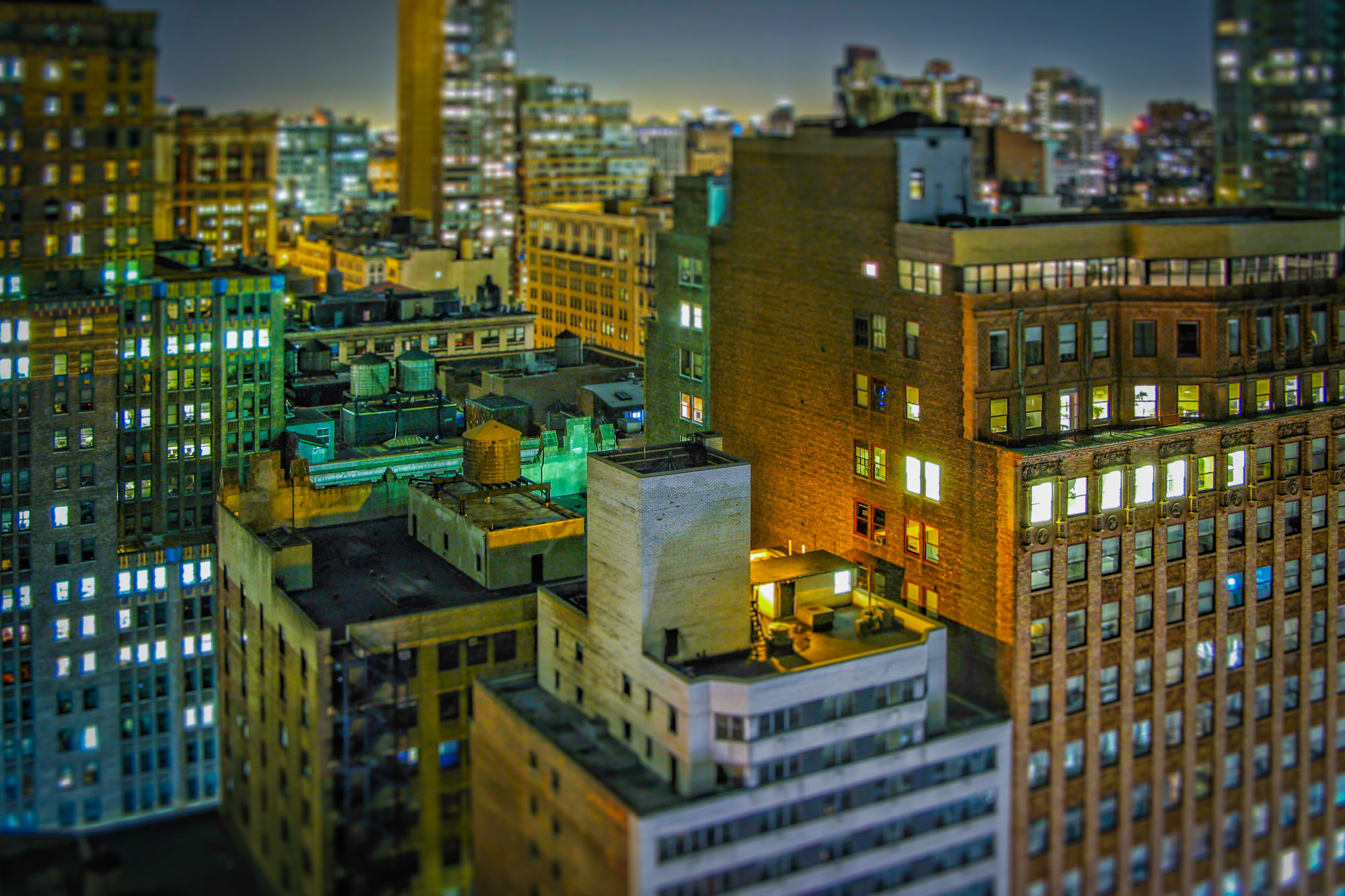 long exposure night photography of Midtown Manhattan rooftops in New York City viewed from above in USA
