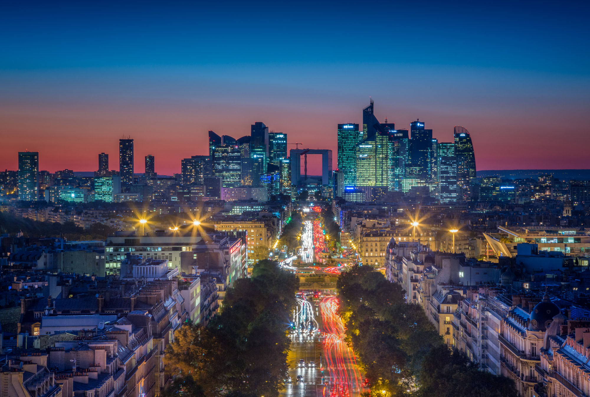 long exposure night photography of the Boulevards in Paris with light trails at sunset viewed from above