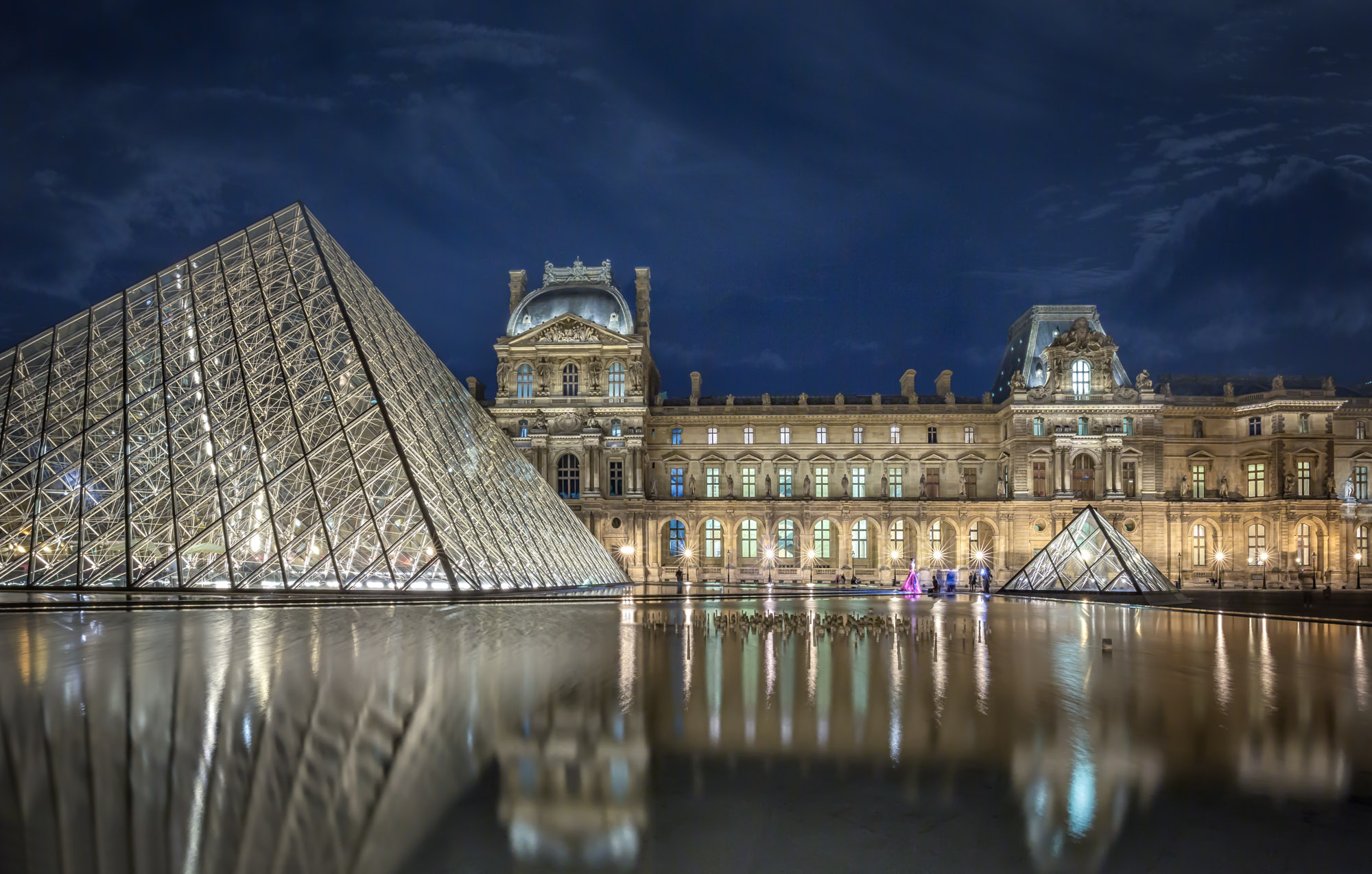 long exposure night photography of the Louvre Museum in Paris France