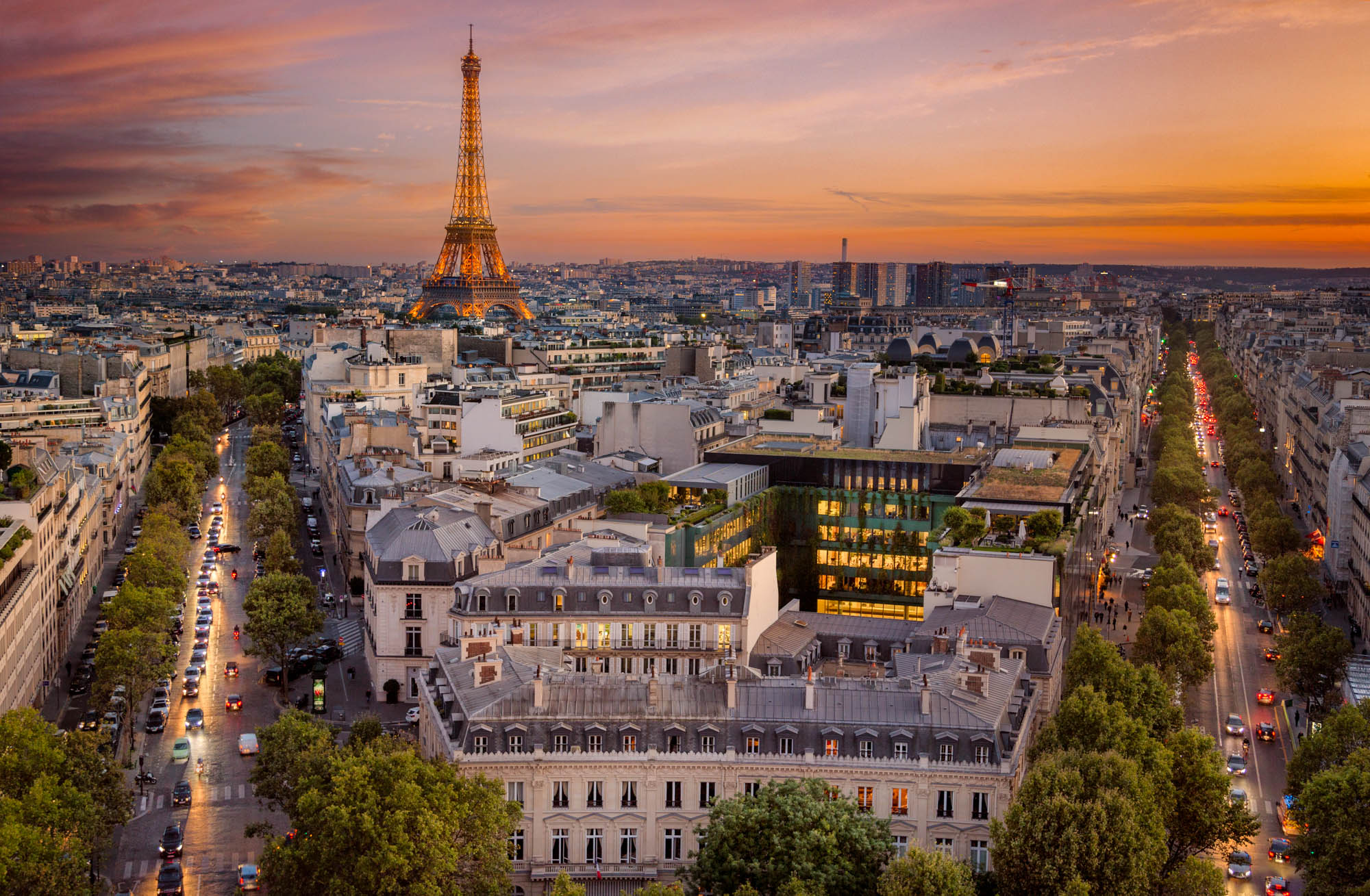 long exposure photography of the Eiffel Tower in Paris France at sunset viewed from rooftops