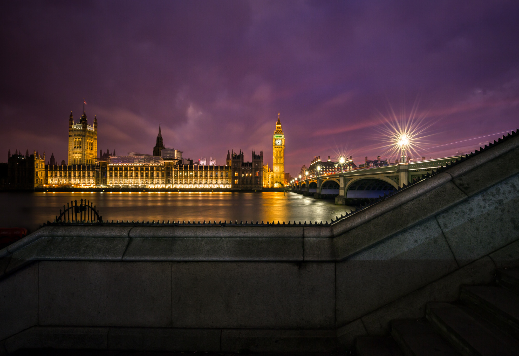 long exposure night photography of Big Ben Eliabeth Clock tower and parliament Westminster Palace in London UK with Westminster Bridge