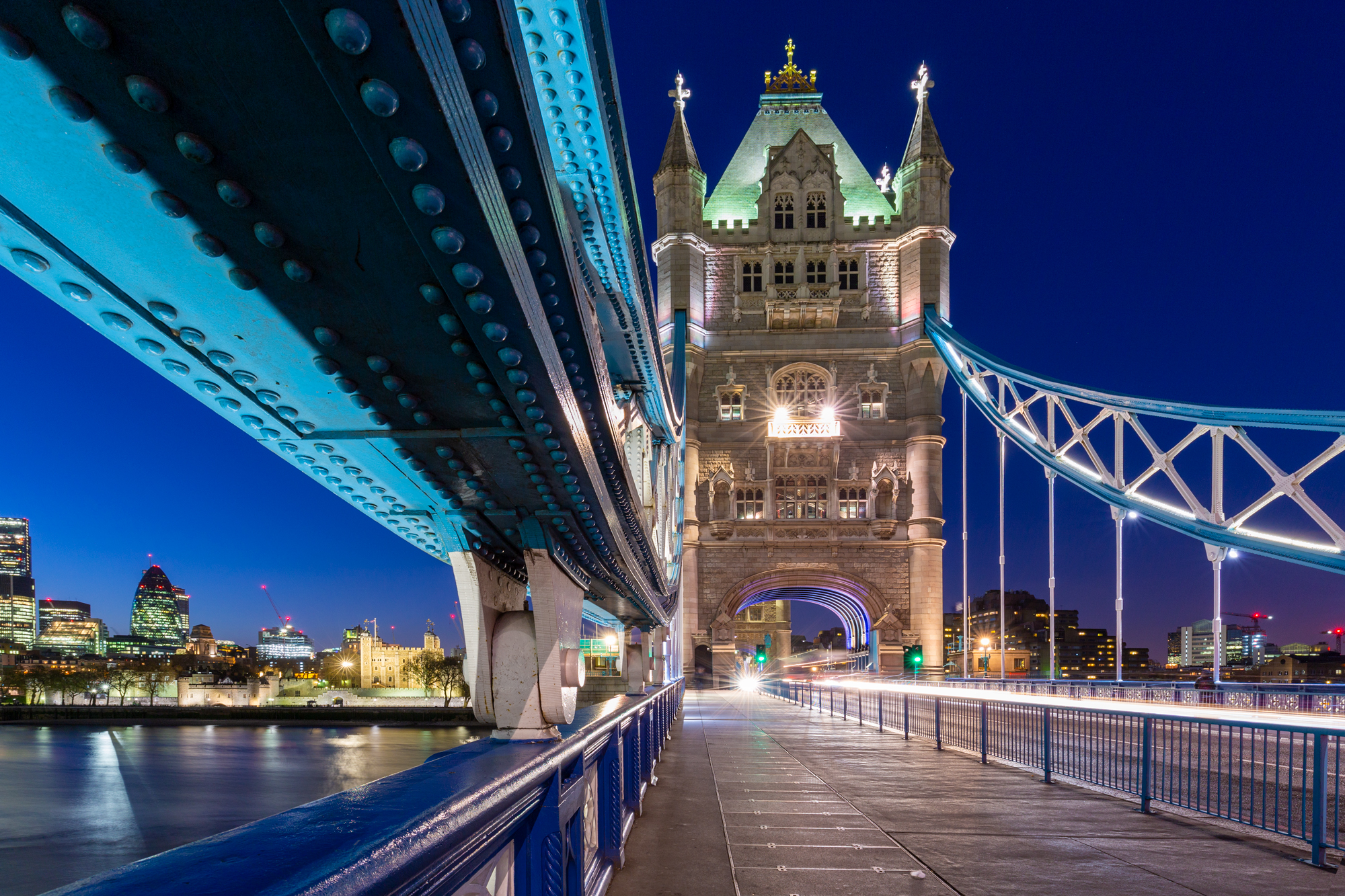 long exposure night photography of the Tower Bridge and the London Skyline beside the River Thames in London UK