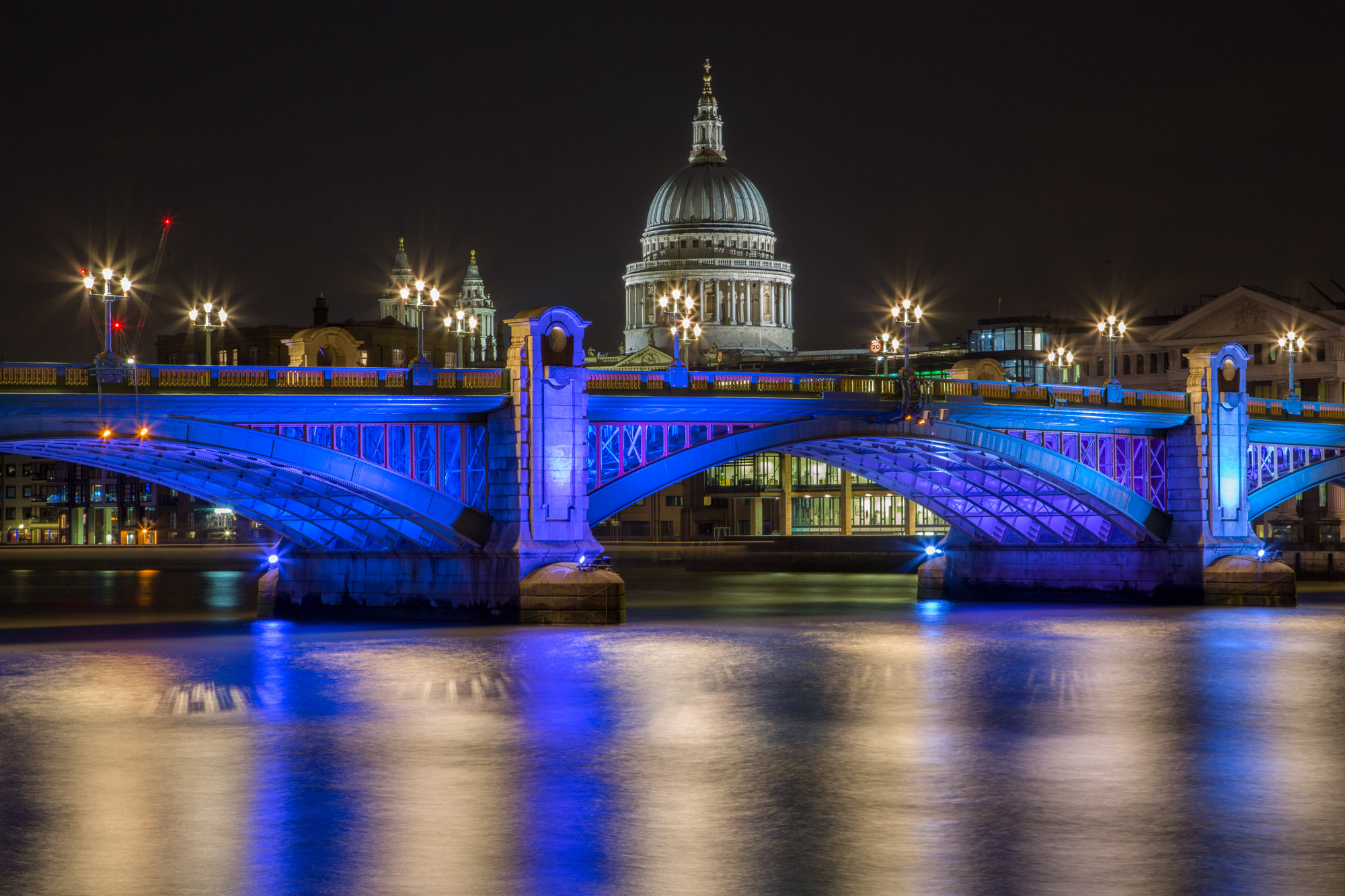 long exposure night photography of the Southwark Bridge and St Pauls Cathedral along the River Thames in London UK