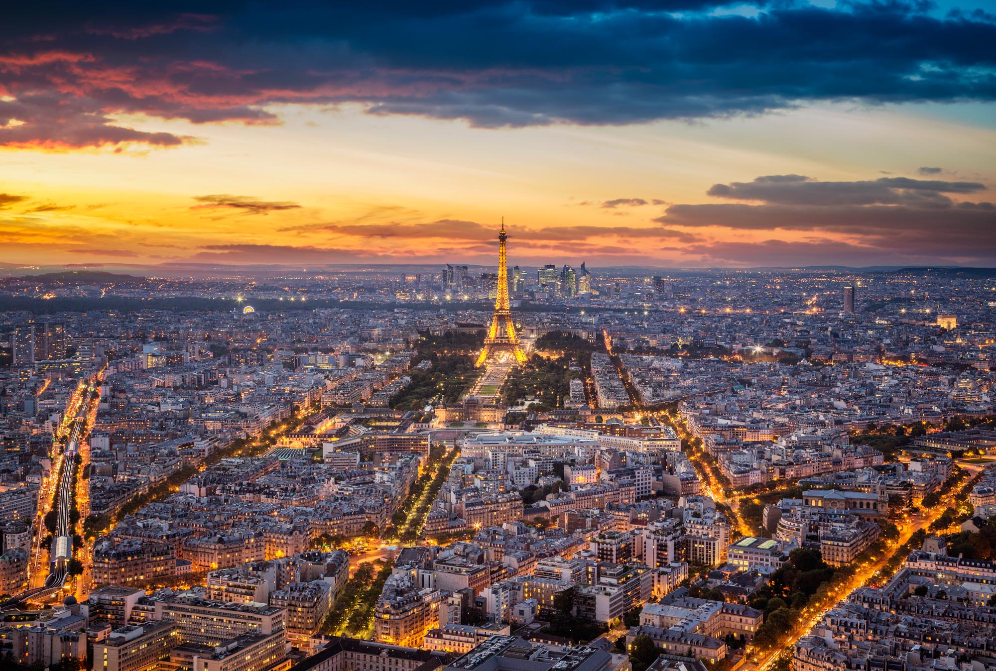 long exposure night photography of the Eiffel Tower and Paris lights at sunset viewed from above
